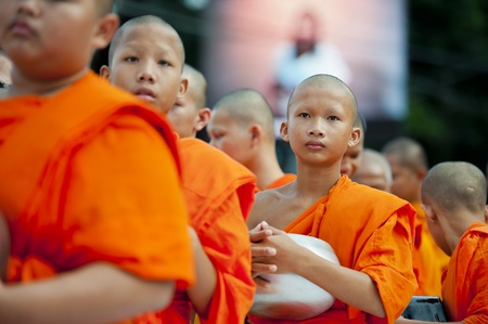 monk robe: Bangkok, Thailand – July 7, 2012: Alms giving-ceremony - Thousands of monks celebrate the enlightenment of Siddhartha Gautama, which dates back 2600 years ago