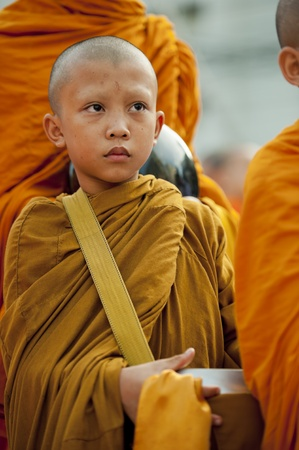 thai monk: Bangkok, Thailand – July 7, 2012: Alms giving-ceremony - Thousands of monks celebrate the enlightenment of Siddhartha Gautama, which dates back 2600 years ago