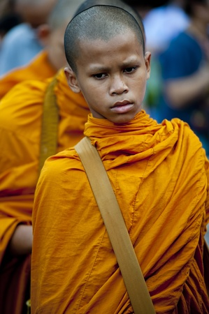 gautama: Bangkok, Thailand � July 7, 2012: Alms giving-ceremony - Thousands of monks celebrate the enlightenment of Siddhartha Gautama, which dates back 2600 years ago