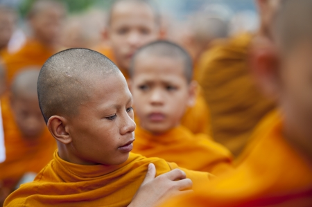 monks: Bangkok, Thailand – July 7, 2012: Alms giving-ceremony - Thousands of monks celebrate the enlightenment of Siddhartha Gautama, which dates back 2600 years ago