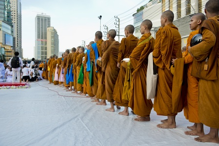 Bangkok, Thailand � July 7, 2012: Alms giving-ceremony - Thousands of monks celebrate the enlightenment of Siddhartha Gautama, which dates back 2600 years ago