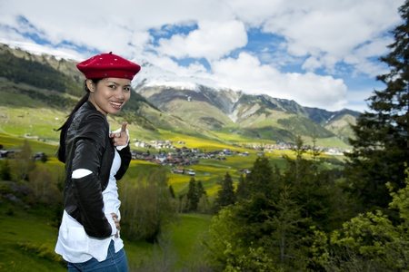 happy asian woman in the alps photo