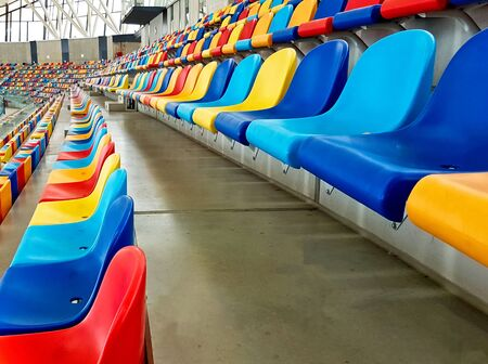 Benches of different colors in a sports stadium