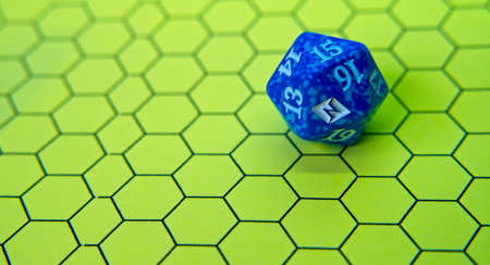 Role-playing board with blue dice on top in a pentagonal shape