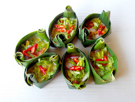 background food: Egg in banana leaf cup