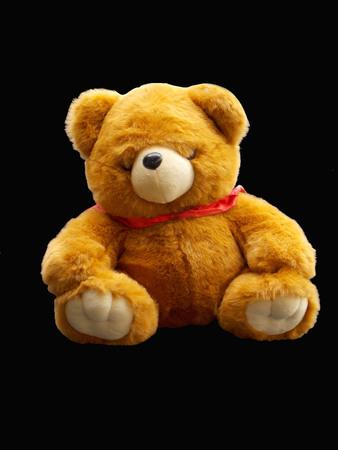 bear doll: Bear doll isolated on black