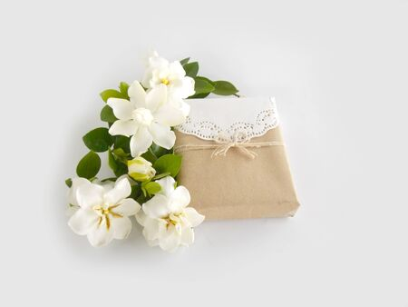 Gift box with white gardenia flower