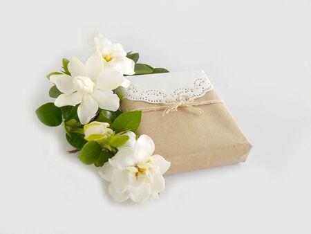 Gift box with white gardenia flower