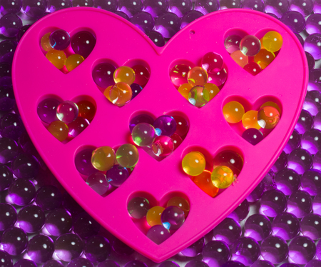 absorbent: hydrogel colored balls, beautiful background, decorative heart