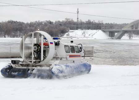 hovercraft: Amphibian rescue boat on the shore of a frozen channel, the Russian rescue boat.Hovercraft. Stock Photo