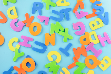 Chaotically scattered alphabet. Background of multi-colored letters.