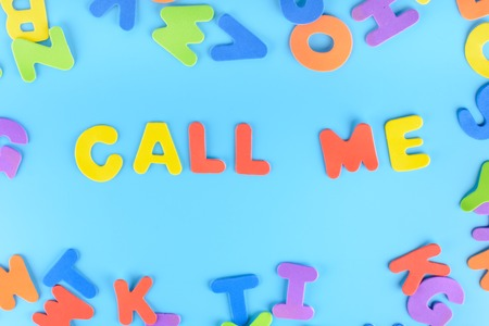 The phrase Call Me is laid out in brightly colored letters. Beautiful background.