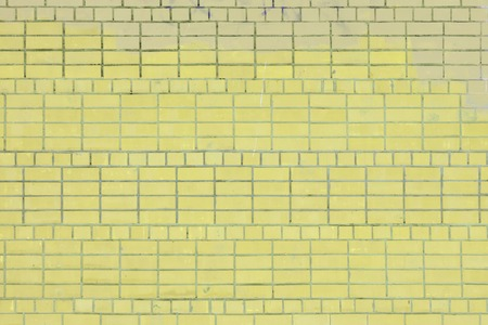 Blank background. Wall of light yellow brick. Layout. The texture of the stone, even rows.