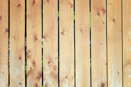 The fence of flat boards. Wooden vertical bars. Background with old wood texture. Stok Fotoğraf