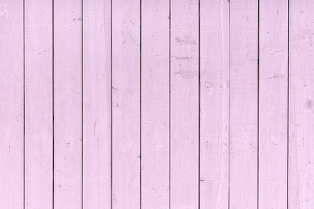 A fence of vertical pink boards. Background with a texture of wooden slats. Stok Fotoğraf