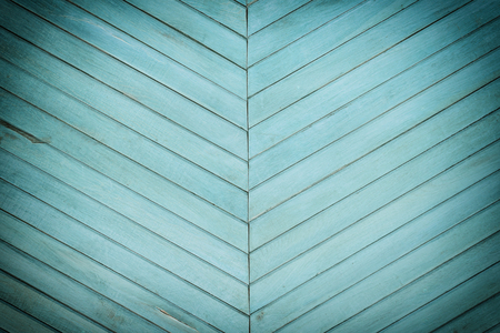 A wall made of diagonal slats. Bright green background with a texture of thin wooden boards. Stock Photo