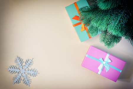 Under the New Year tree are gifts in colorful boxes, a picture from above. Place for text, copy space.
