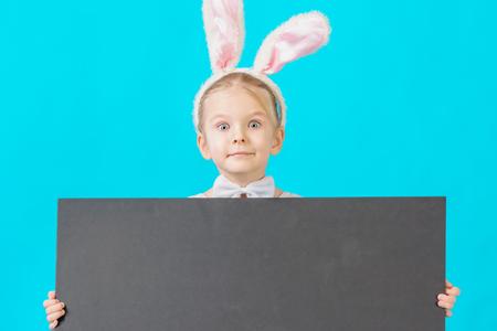 Little girl in a white rabbit costume. Фото со стока