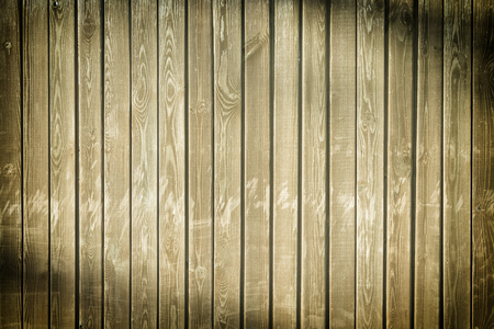 The fence of flat vertical boards. Empty background with wood texture.