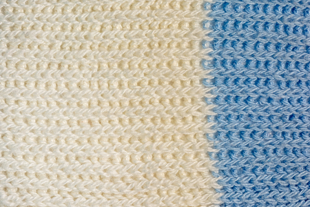 Texture, two-color knitted jersey close-up. Blank white-blue wool background. Archivio Fotografico