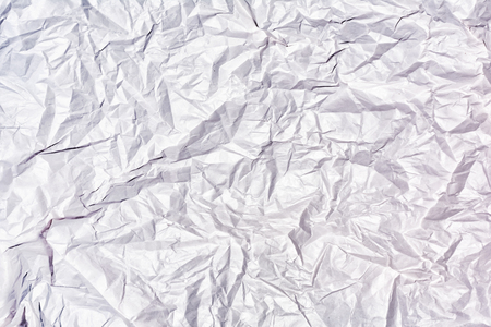 Texture of crumpled white paper close up. Blank abstract background.