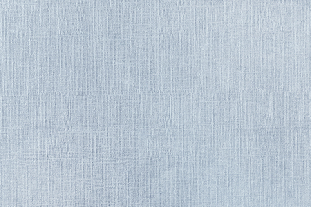 Texture of blue paper with unevenness and embossed close-up. Background for layouts.
