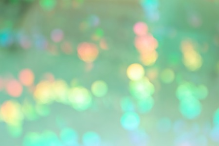 Beautiful abstract background. Multicolored spots in blur on green. Imagens