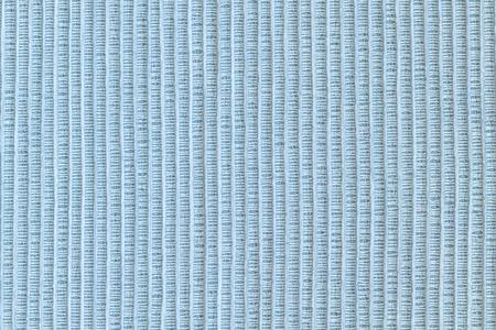 Textur aus dickem Stoff hautnah. Leerer blauer Hintergrund.