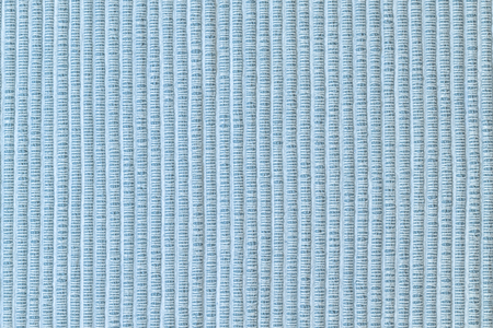 Texture of thick fabric close up. Empty blue background.