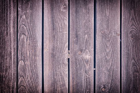 Texture of old wood. Fence of vertical old boards.