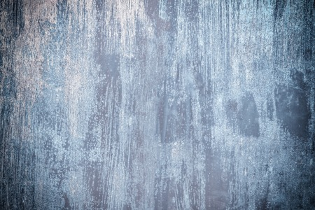 Abstract background with place for text. Old metal fence unevenly painted with dirty blue paint.