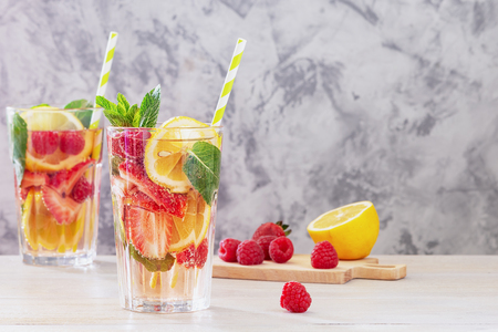 Lemonade with berries and mint. Reklamní fotografie