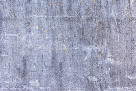 Gray abstract background, stray leaf sheet of slate with cracks and scratches. The basis for the layout.