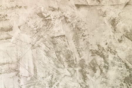 Abstract light gray background. Straya plaster wall with scratches and roughness. The basis for the layout.