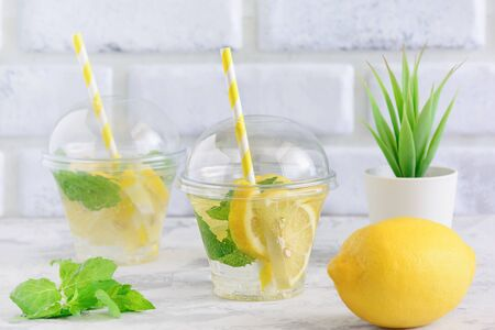 Cold Refreshing Citrus Mint Sassy Water Beverage. Dietary Lemonade Served in Glass with Straw.