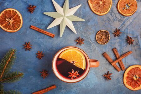 Cup Of Hot Mulled Wine with Spices and Citrus