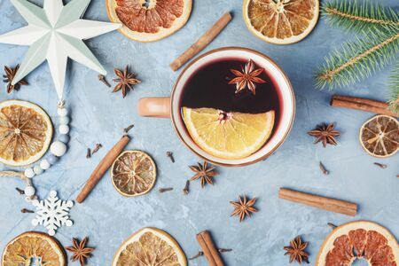 Cup Of Mulled Wine with Spices and Orange Fruit Flat Lay Copyspace Photo Reklamní fotografie
