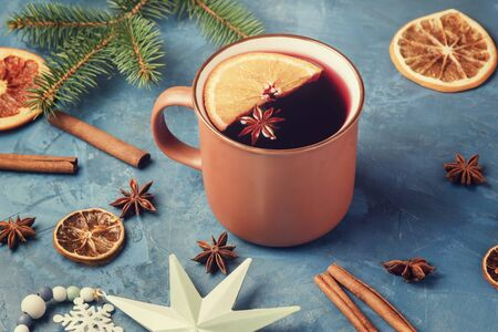 Brown Ceramic Cup with Red Warming Mulled Wine Made from Cinnamon Stick, Anise and Sliced Orange.