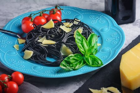 Black pasta with basil and parmesan.
