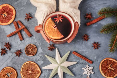 Woman Hands Holding Cup with Aromatic Mulled Wine with Spices and Orange Fruit Top View Copy Space Reklamní fotografie