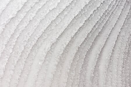 Unusual ice patterns. Crystals of snow in stripes.