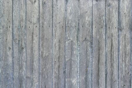 Fence from old, shabby boards.