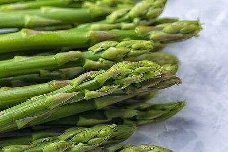 Fresh asparagus sprouts closeup.
