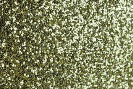 Green shiny small sparkles closeup.