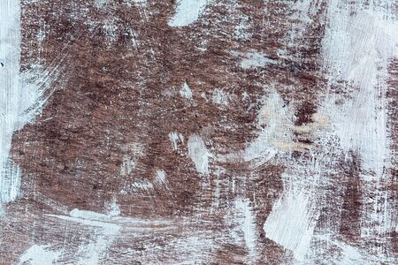 Abstract background, brown wall with strokes of white paint. Photography, for sites and layouts.