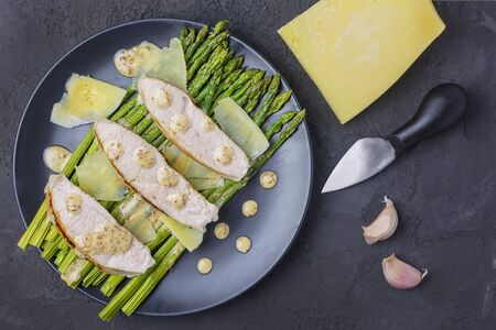 A photo on top of wholesome food. Boiled turkey and asparagus with garlic sauce. Tasty lunch or dinner. 版權商用圖片