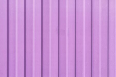 Brightly lilac painted sheet of corrugated metal. Abstract background for sites and layouts. 版權商用圖片