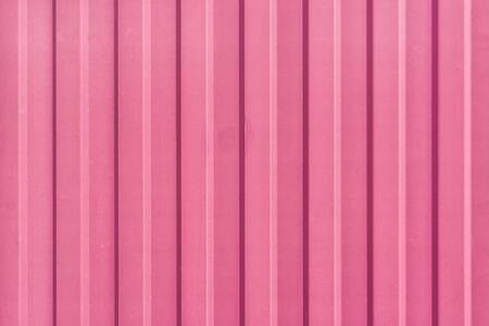 A bright pink painted sheet of corrugated metal. Abstract background for sites and layouts. 版權商用圖片