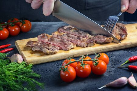 The steak is cut into portions. Meat with blood. Tasty restaurant dish. 版權商用圖片