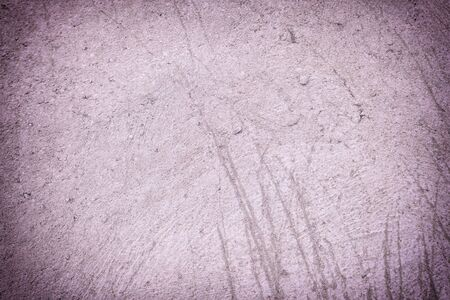 Abstract lilac scratched background. Fragment of an old plastered wall. Photo for sites and layouts with vignette. 版權商用圖片